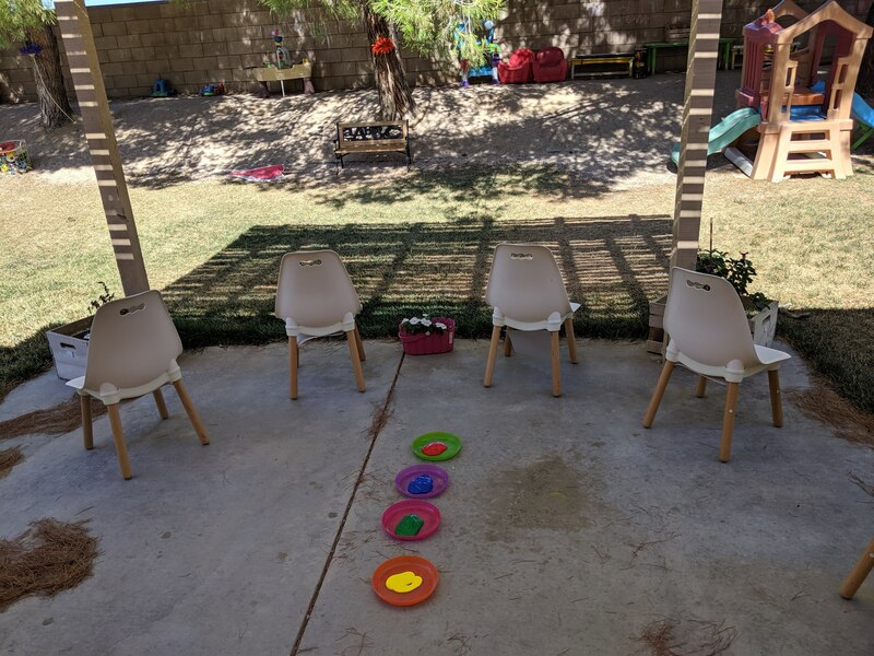 Children learning about outside art with Experience Early Learning
